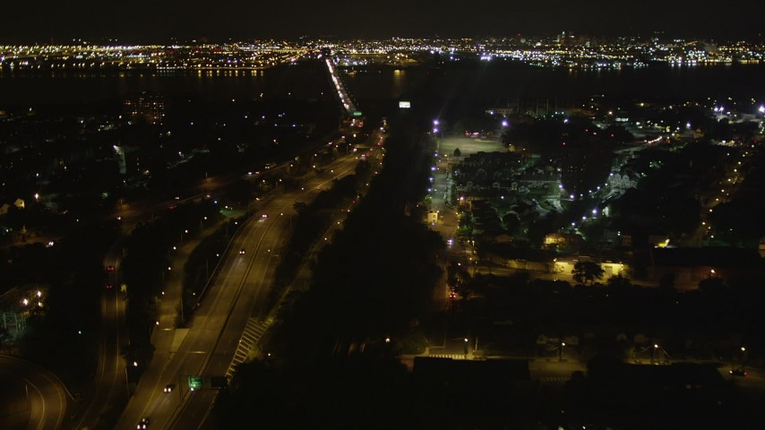 4K stock footage aerial video Flying over New Jersey Turnpike, Newark Bay Bridge, Newark, New Jersey, night Aerial Stock Footage | AX85_139