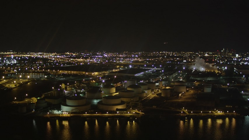 4K stock footage aerial video Flying by an oil refinery, Newark Bay, Newark, New Jersey, night Aerial Stock Footage | AX85_144