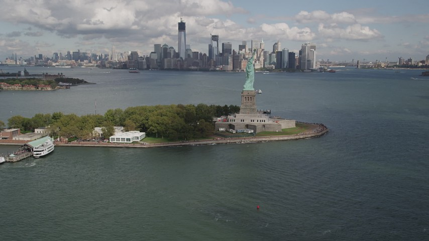 5k aerial video Reveal Statue of Liberty, Liberty Island, Lower Manhattan, New York Aerial Stock Footage | AX87_001