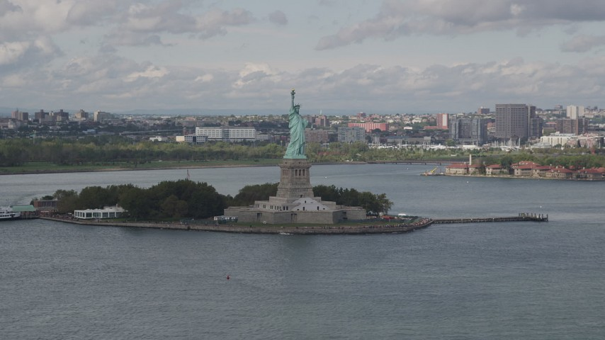 4K stock footage aerial video Flying by the Statue of Liberty, Liberty Island,  New York, New York Aerial Stock Footage | AX87_003