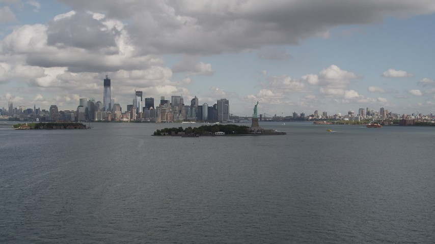 4K stock footage aerial video Reveal Statue of Liberty, Lower Manhattan skyline, New York, New York Aerial Stock Footage | AX87_004