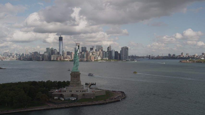 4K stock footage aerial video Fly by Statue of Liberty, Lower Manhattan skyline, New York, New York Aerial Stock Footage AX87_006