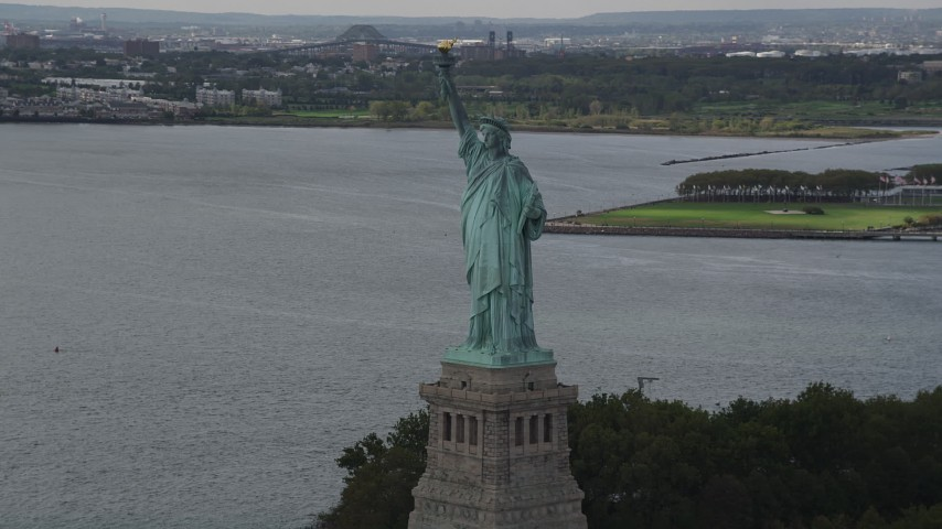 4K stock footage aerial video Flying slowly by Statue of Liberty, Liberty Island, New York, New York Aerial Stock Footage | AX87_008