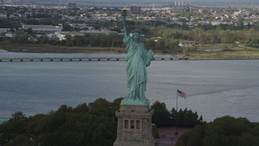 4K stock footage aerial video Flying by the front of the Statue of Liberty, Liberty Island, New York, New York Aerial Stock Footage | AX87_009