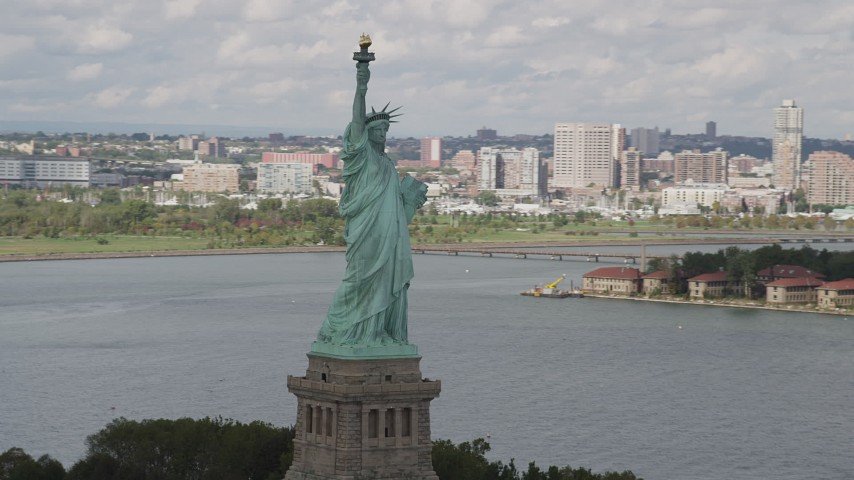 4K stock footage aerial video Flying by the side of the Statue of Liberty, Liberty Island, New York, New York Aerial Stock Footage | AX87_010