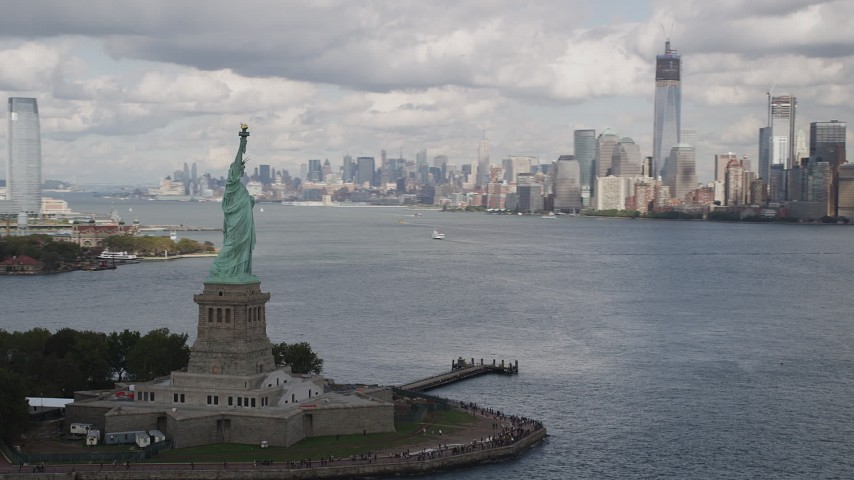 4K aerial video Orbit Statue of Liberty, Lower Manhattan skyline, New York, New York Aerial Stock Footage | AX87_013