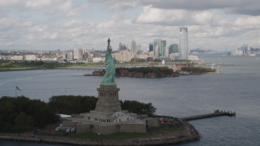4K stock footage aerial video Flying by the front of the Statue of Liberty, Liberty Island, New York, New York Aerial Stock Footage | AX87_014