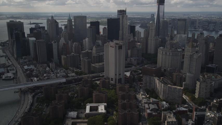 4K stock footage aerial video Tilt up from Lower East Side, revealing Lower Manhattan, New York, New York Aerial Stock Footage | AX87_024