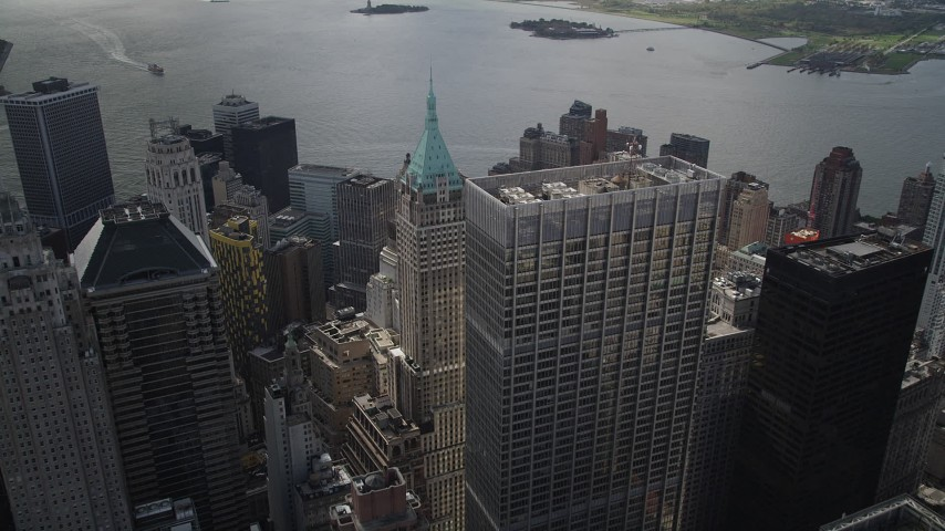 4K stock footage aerial video of One Chase Manhattan Plaza, 40 Wall Street, Lower Manhattan, New York, New York Aerial Stock Footage | AX87_027
