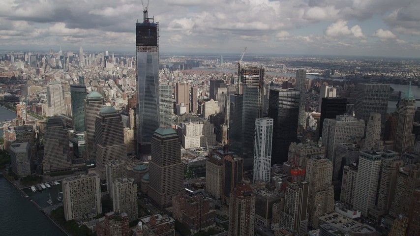 4K stock footage aerial video Fly by Freedom Tower, World Trade Center skyscrapers, Lower Manhattan, New York Aerial Stock Footage | AX87_030