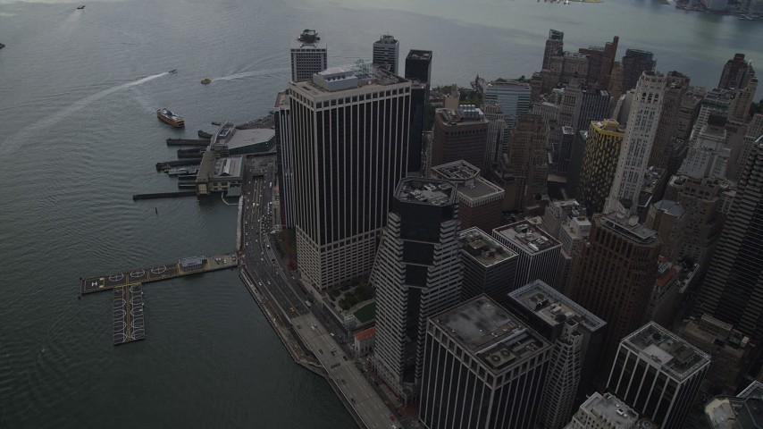 4K stock footage aerial video Flying by Lower Manhattan skyscrapers, East River, New York, New York Aerial Stock Footage | AX87_039