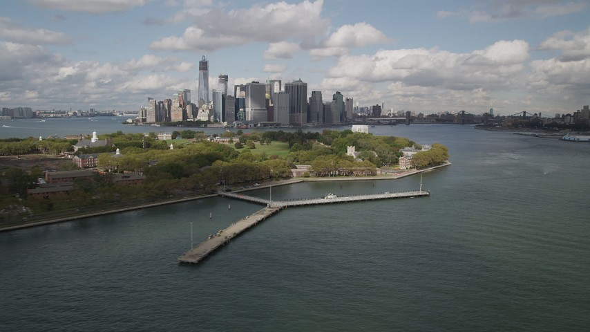 4K stock footage aerial video Flying by Lower Manhattan skyline, from Governors Island, New York, New York Aerial Stock Footage | AX87_043