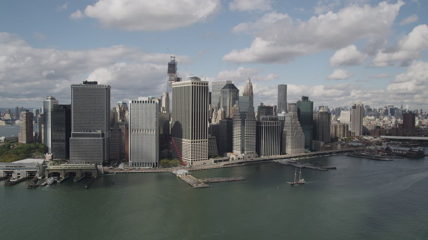 4K stock footage aerial video Approaching Lower Manhattan skyscrapers on the shore, New York, New York Aerial Stock Footage | AX87_047