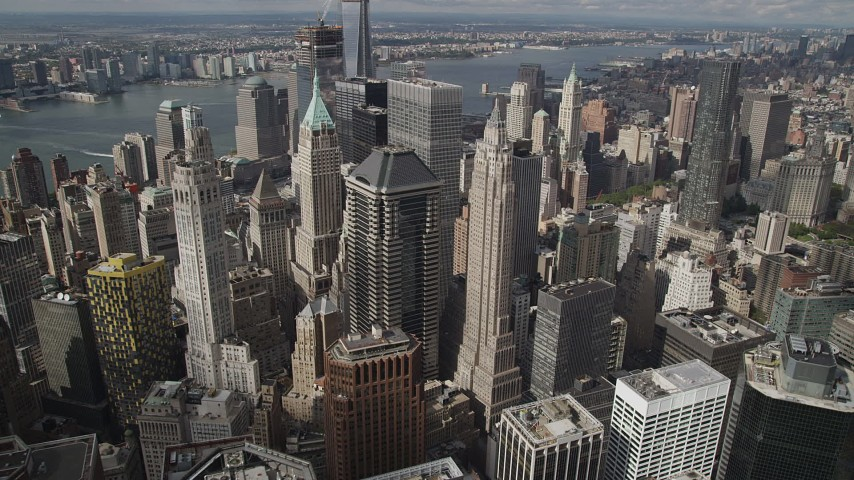 5k aerial video Flying over Lower Manhattan skyscrapers, New York, New York Aerial Stock Footage | AX87_049