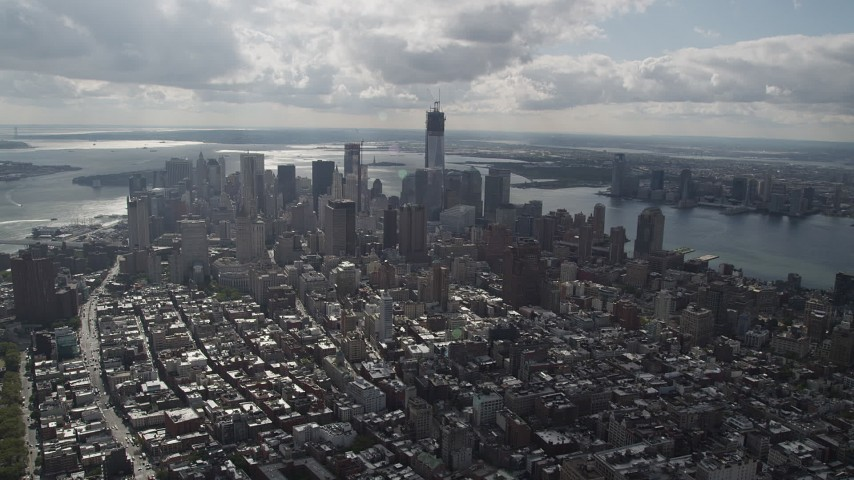 4K stock footage aerial video Flying by Lower Manhattan, seen from Lower East Side, New York, New York Aerial Stock Footage | AX87_054