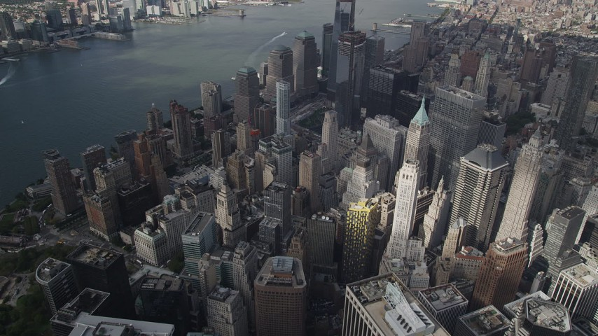 5k aerial video Flying away from skyscrapers in Lower Manhattan, New York, New York Aerial Stock Footage | AX87_061