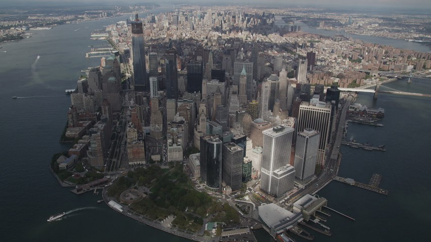 4K stock footage aerial video Tilt up to reveal Lower Manhattan from a high altitude, New York, New York Aerial Stock Footage | AX87_064