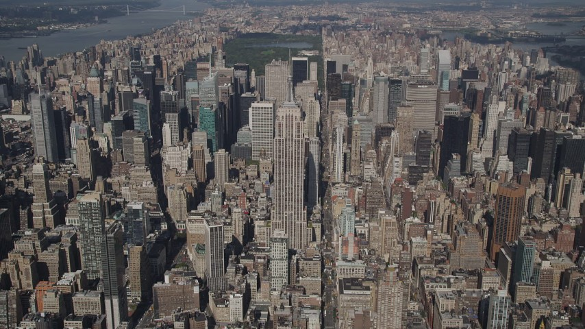 4K stock footage aerial video Tilt up to reveal Empire State Building, Midtown Manhattan, New York, New York Aerial Stock Footage | AX87_075
