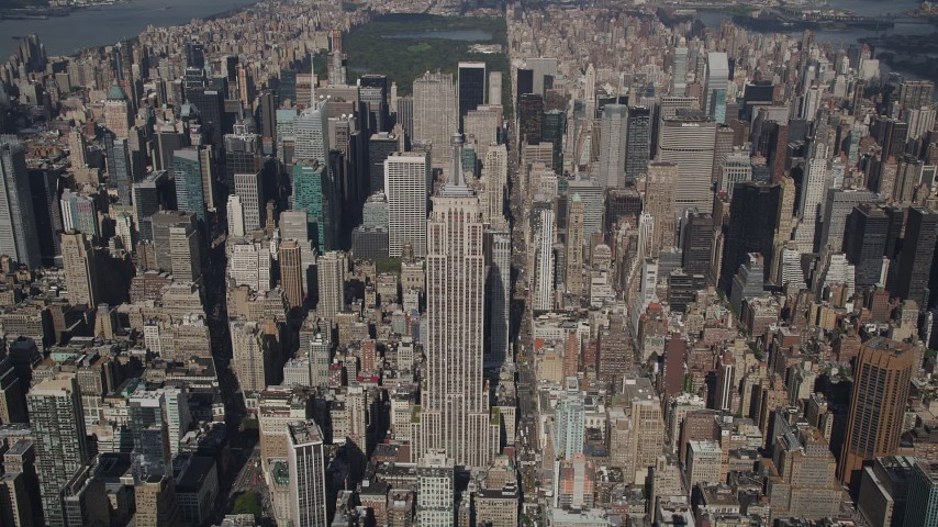 4K stock footage aerial video Approaching the Empire State Building, tilt down, Midtown Manhattan, New York Aerial Stock Footage | AX87_076