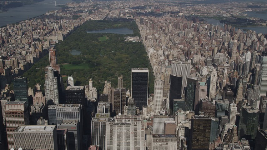 4K stock footage aerial video Tilt up from Midtown skyscrapers, revealing Central Park, New York, New York Aerial Stock Footage | AX87_079