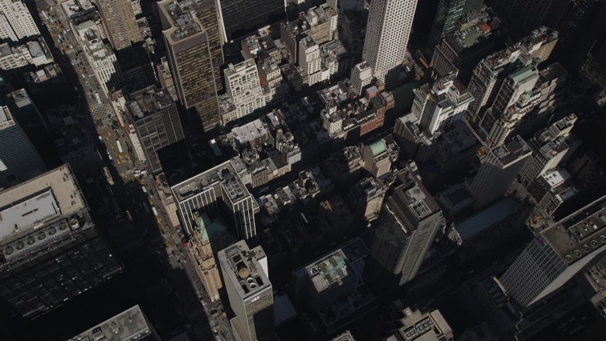 4K stock footage aerial video Flying over city streets, skyscrapers, Midtown Manhattan, New York, New York Aerial Stock Footage | AX87_080