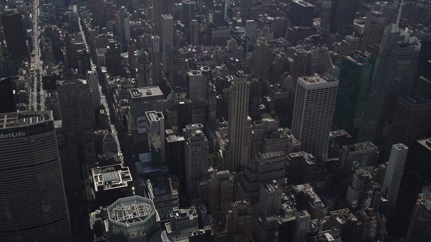 4K stock footage aerial video Tilt up from Waldorf-Astoria, revealing Midtown Manhattan, New York, New York Aerial Stock Footage | AX87_083