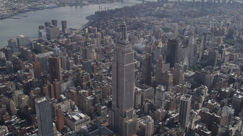 4K stock footage aerial video Flying by the Empire State Building, Midtown Manhattan, New York, New York Aerial Stock Footage | AX87_087