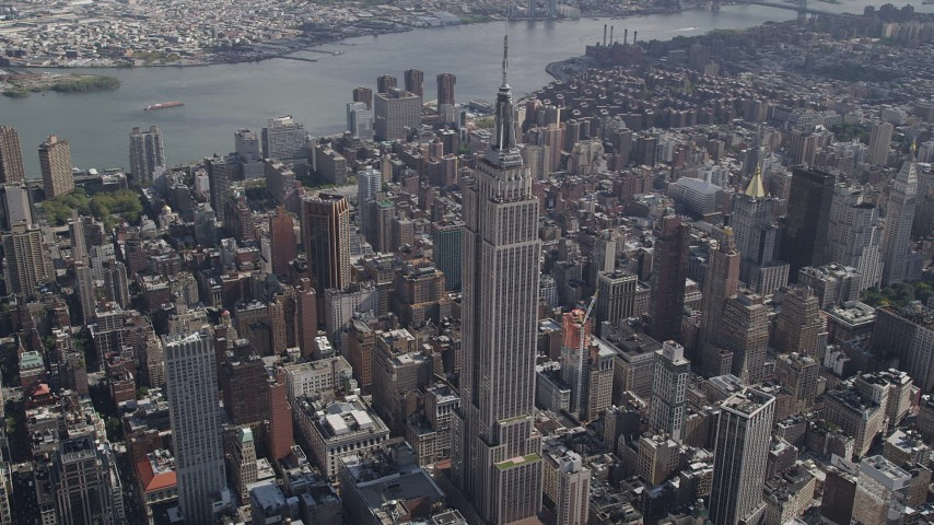 4K aerial video Flying by the Empire State Building, Midtown Manhattan, New York, New York Aerial Stock Footage | AX87_088