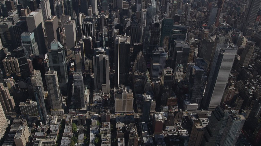 4K stock footage aerial video Tilt up to reveal Midtown Manhattan skyscrapers, New York, New York Aerial Stock Footage | AX87_090