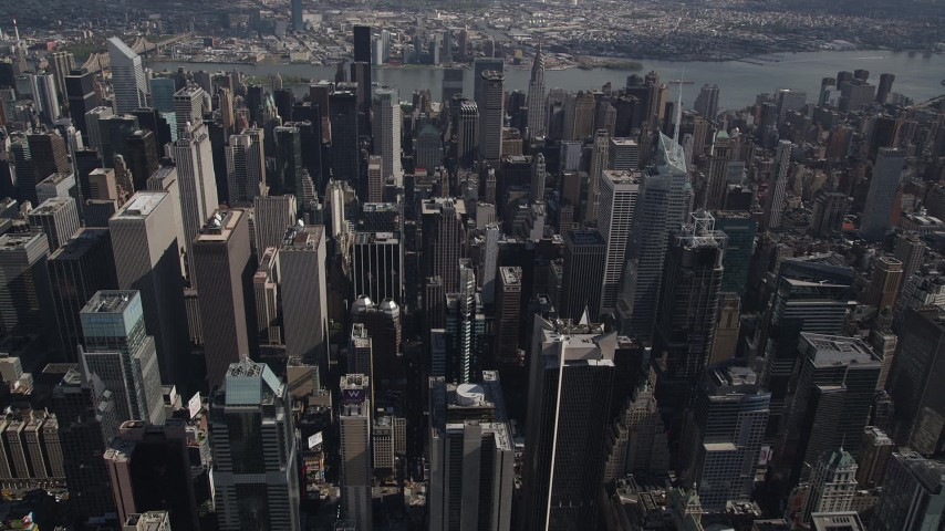 4K stock footage aerial video Flying over skyscrapers, Midtown Manhattan, New York, New York Aerial Stock Footage | AX87_091