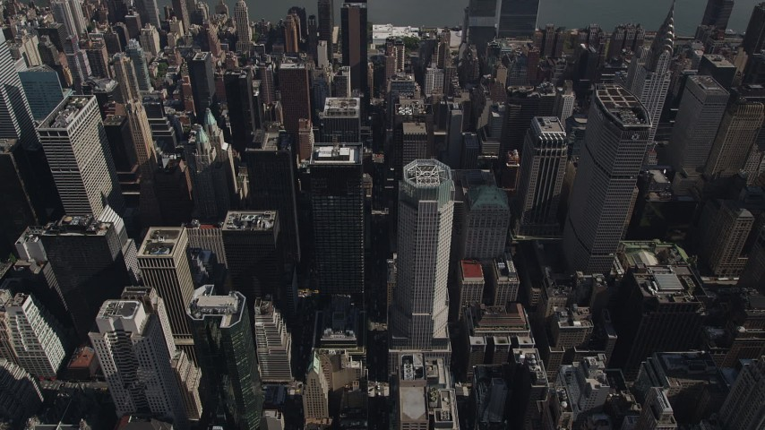 4K aerial video Approaching Midtown Manhattan skyscrapers, tilt down, New York, New York Aerial Stock Footage | AX87_093