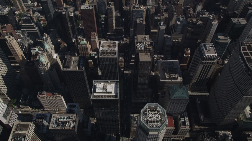 4K stock footage aerial video Flying over Midtown Manhattan skyscrapers, tilt down, New York, New York Aerial Stock Footage | AX87_094