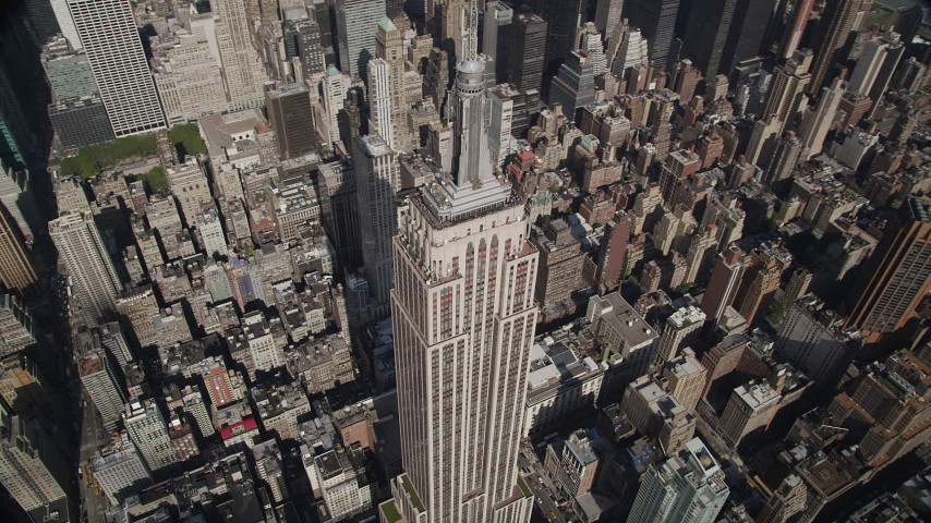 4K stock footage aerial video Orbiting the Empire State Building, tilt up,  Midtown Manhattan, New York, New York Aerial Stock Footage | AX87_102
