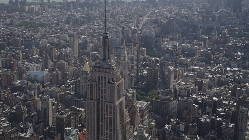 4K stock footage aerial video Flying by the top of the Empire State Building, Midtown Manhattan, New York Aerial Stock Footage | AX87_105