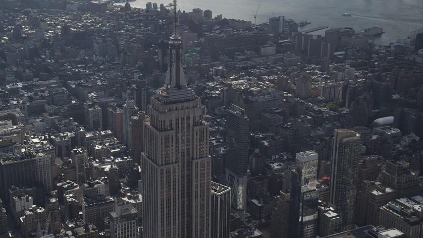 4K stock footage aerial video Flying by top of the Empire State Building, Midtown Manhattan, New York Aerial Stock Footage | AX87_107