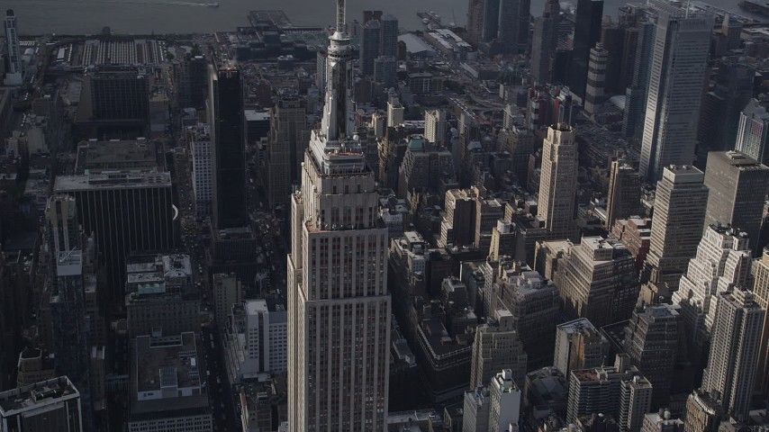 4K stock footage aerial video Flying by the top decks of Empire State Building, Midtown Manhattan, New York Aerial Stock Footage | AX87_110