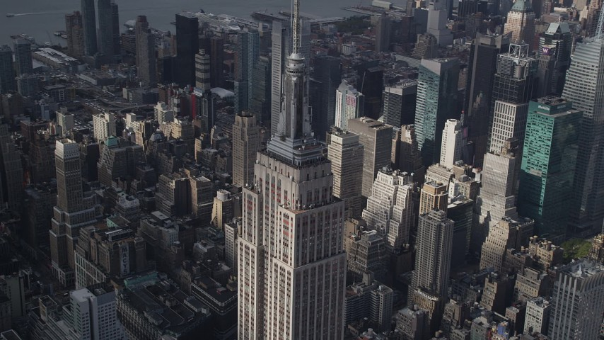 4K stock footage aerial video Flying by the top decks of Empire State Building, Midtown Manhattan, New York Aerial Stock Footage | AX87_111