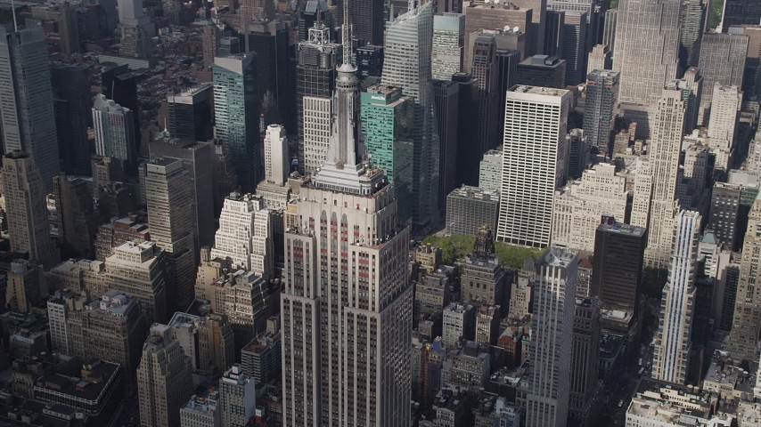 4K stock footage aerial video Flying by top of Empire State Building, Midtown Manhattan skyscrapers, New York Aerial Stock Footage | AX87_112