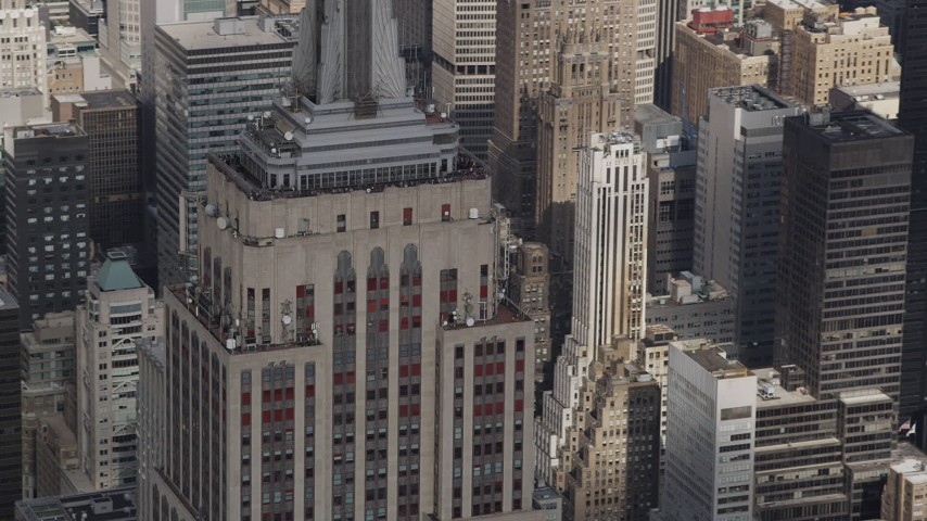 4K aerial video Flying by top decks of the Empire State Building, Midtown Manhattan, New York Aerial Stock Footage | AX87_114