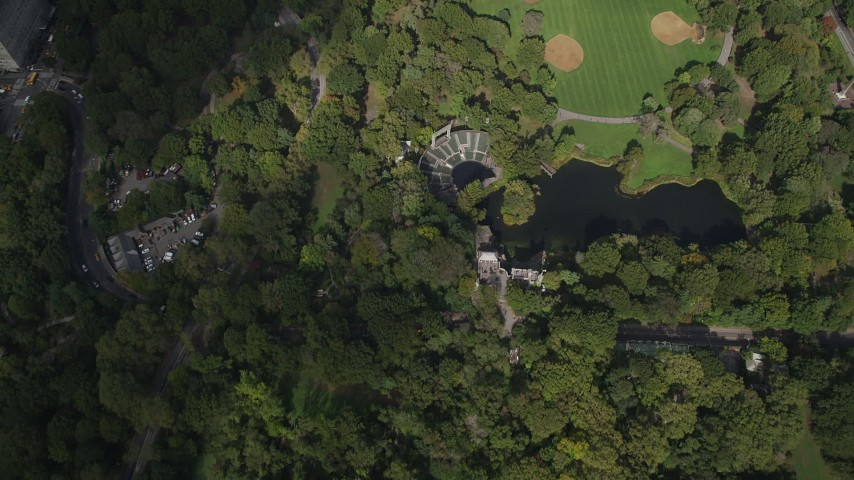4K stock footage aerial video Bird's eye view over Delacorte Theater, Turtle Pond, Central Park, New York Aerial Stock Footage | AX87_121