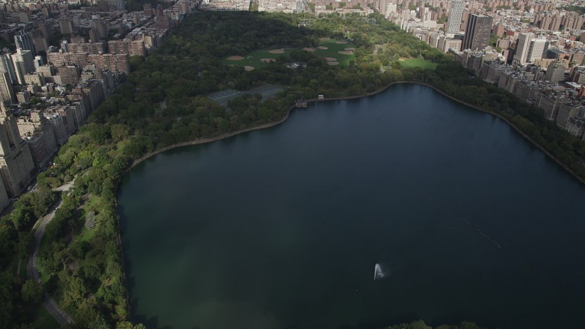 4K stock footage aerial video Flying over Jacqueline Kennedy Onassis Reservoir, Central Park, New York, New York Aerial Stock Footage | AX87_122
