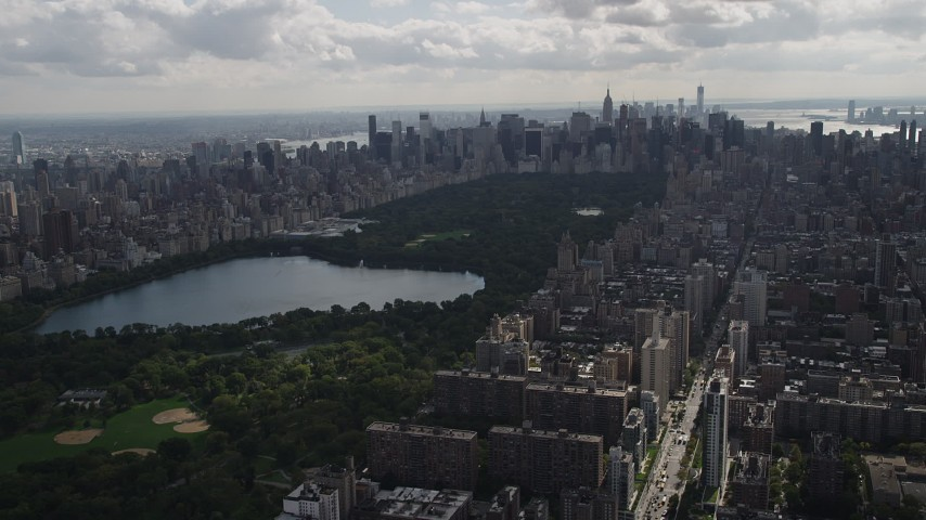 4K stock footage aerial video Flying by Central Park, seen from Upper West Side, New York, New York Aerial Stock Footage | AX87_129