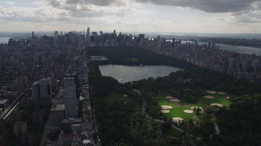 4K stock footage aerial video Flying by Central Park, Upper East Side, seen from Harlem, New York, New York Aerial Stock Footage | AX87_132