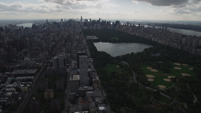 4K stock footage aerial video Flying by Central Park, moving west, New York, New York Aerial Stock Footage | AX87_136