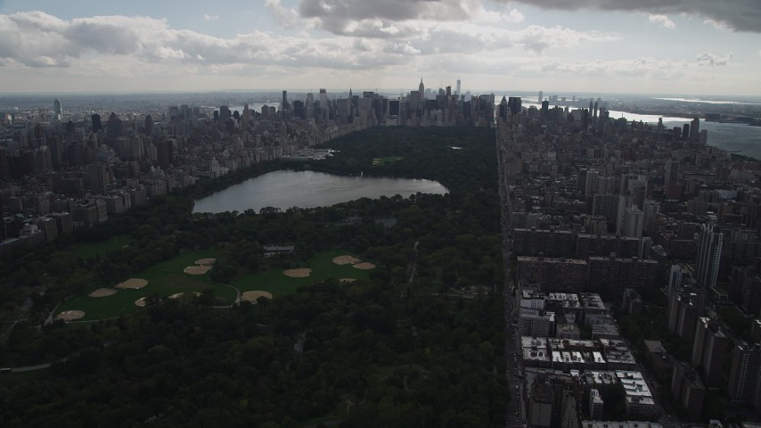 4K stock footage aerial video Flying by Central Park, over Upper West Side, New York, New York Aerial Stock Footage | AX87_139