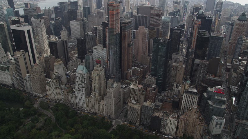 4K aerial video Approaching Midtown Manhattan skyscrapers, from Central Park, New York Aerial Stock Footage | AX87_150