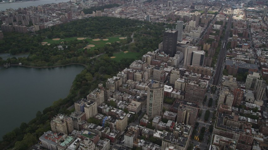 5k aerial video Flying over Upper East Side buildings, Central Park, New York, New York Aerial Stock Footage | AX87_156
