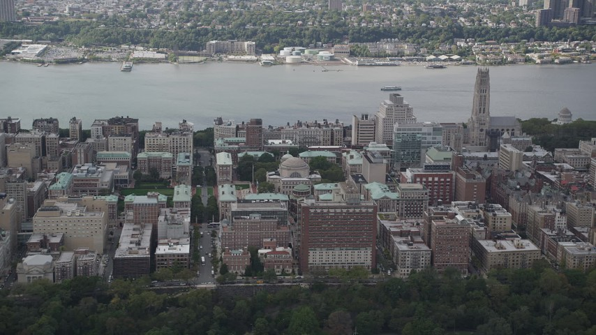 4K stock footage aerial video Flying by Columbia University, with views of the Hudson River, New York, New York Aerial Stock Footage | AX87_159