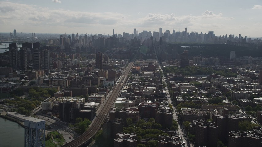 4K stock footage aerial video Flying by the Midtown Manhattan skyline, seen from Harlem, New York, New York Aerial Stock Footage | AX87_180