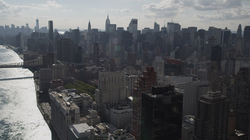 4K stock footage aerial video Fly by Midtown Manhattan skyscrapers, from Upper East Side, New York Aerial Stock Footage | AX87_187